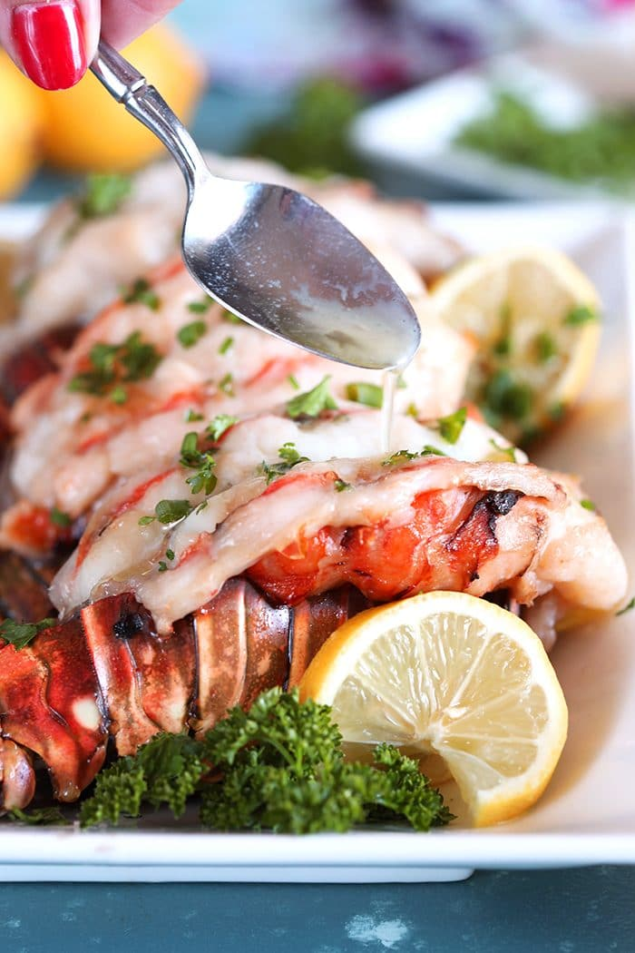 Baked Lobster Tail being drizzled with melted butter.