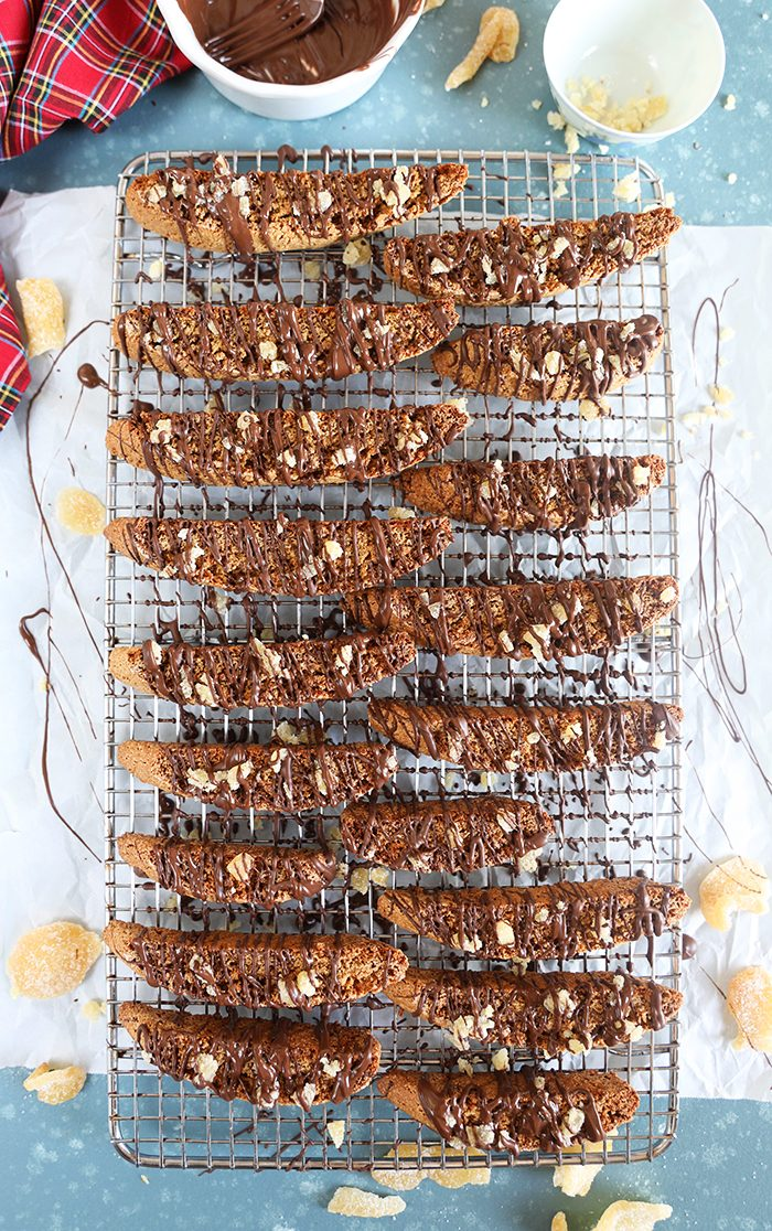 Gingerbread biscotti on a wire cooling rack with parchment underneath.