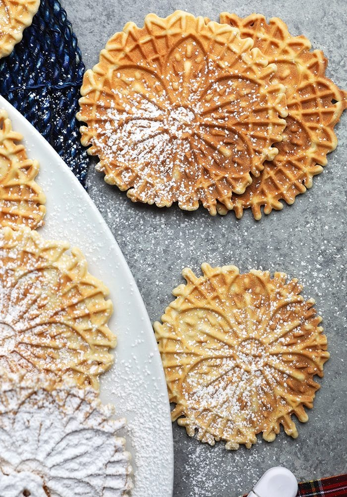 Pizzelles on a gray background.