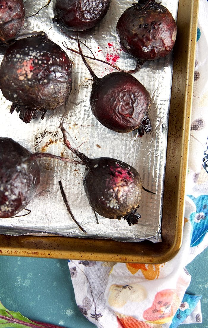 Overhead shot of roasted beets on a baking sheet.