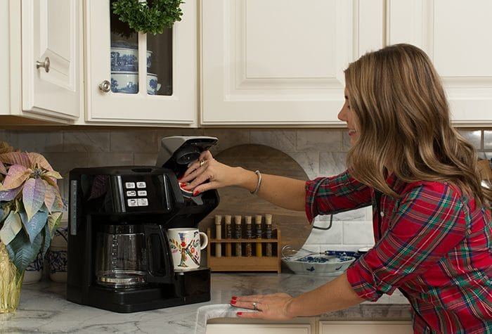 Photo of The Suburban Soapbox putting a K Cup into the Hamilton Beach FlexBrew Coffee Maker.