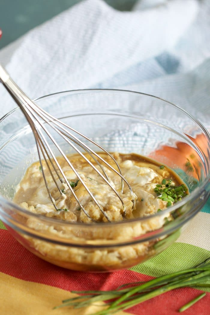 Creamy Horseradish ingredients being whisked in a glass bowl.