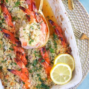 Overhead shot of Baked Shrimp Scampi Casserole in a white baking dish.