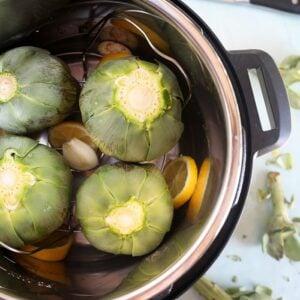 Overhead shot of artichokes in an Instant Pot.