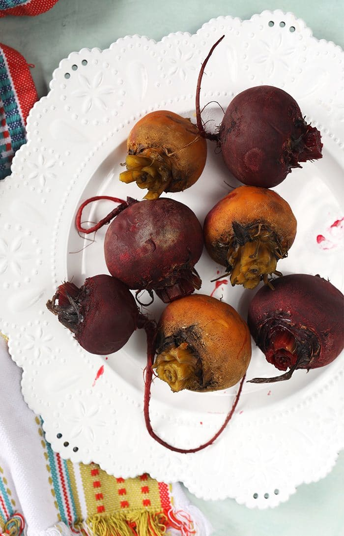 Cooked beets on a white plate.