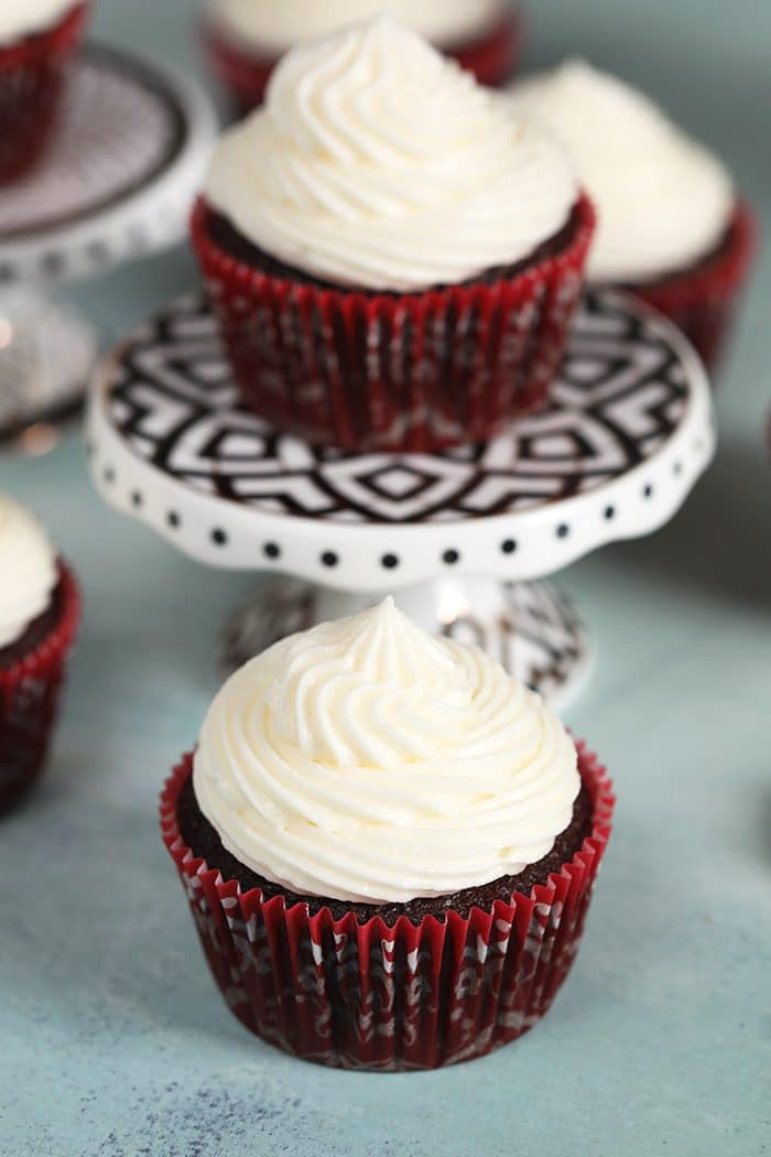 Chocolate cupcakes with whipped cream cheese frosting.