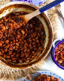 Overhead shot of boston baked beans in a blue and white casserole dish.
