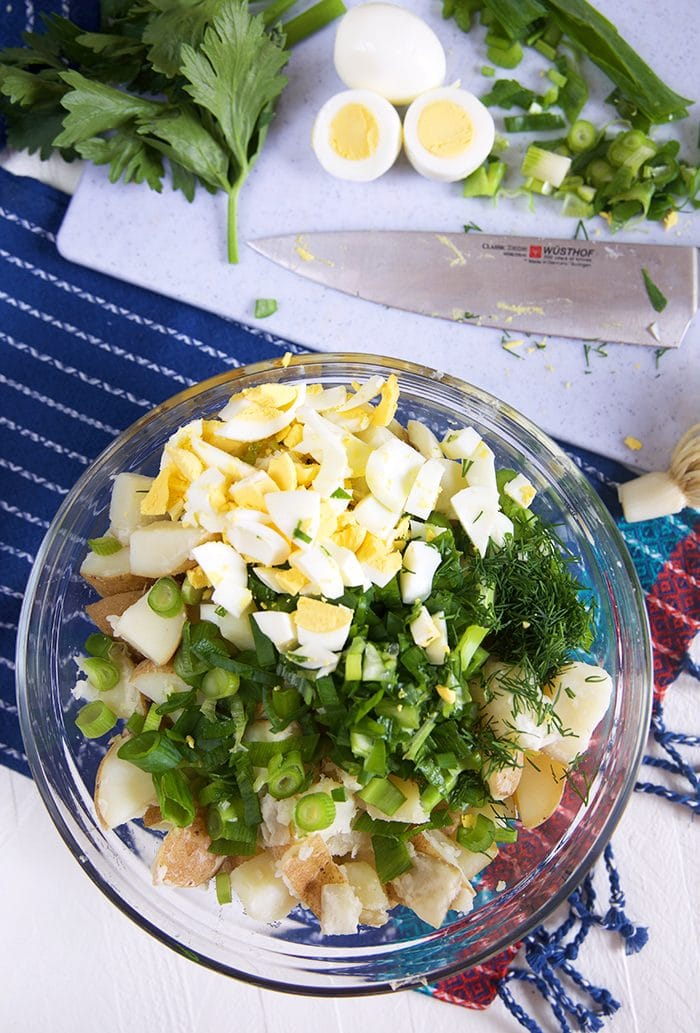 Overhead shot of potato salad ingredients in a bowl.