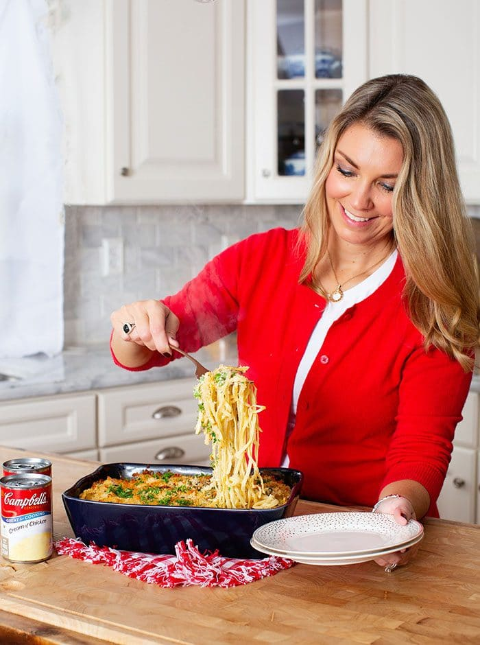 Pasta being served from a baking dish.