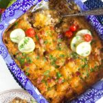 Overhead shot of tater tot casserole hotdish in a blue and white casserole dish.