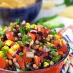 Cowboy Caviar in a red bowl..