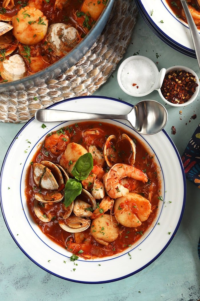 Close up overhead of a bowl of cioppino stew.