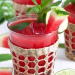 Close up of watermelon water in a seagrass glass.