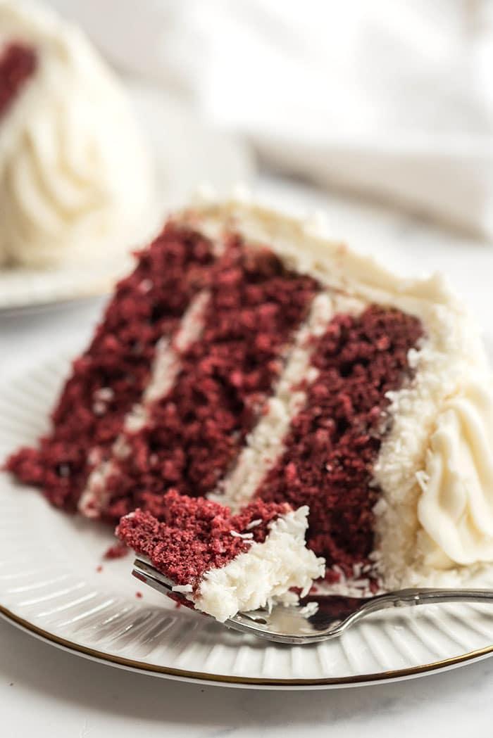 Fork with a bite of red velvet cake.