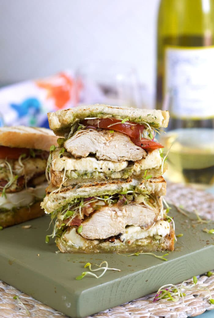 A sandwich has been cut in half and stacked on top of each other.