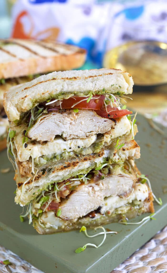 A chicken sandwich is cut down the middle, revealing a perfectly cooked white center.